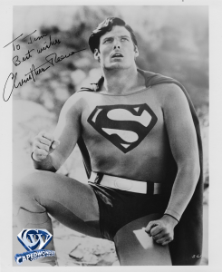 CW-STM-B&W-Reeve-crouched-over-Lois-desert-autographed