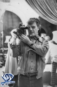 Richard Donner uses an ARRI 16mm film camera, likely one of the cameras used to film the vintage documentaries.