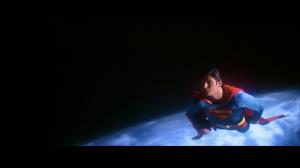 CapedWonder-STM-Superman-smiles-above-earth-071