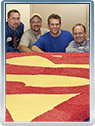 Jamie Reigle, Steve Stanley, Scott Cranford and Jim Bowers with the Superman cake in Cleveland, Ohio, July 2009