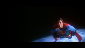 CapedWonder-STM-Superman-smiles-above-earth-075